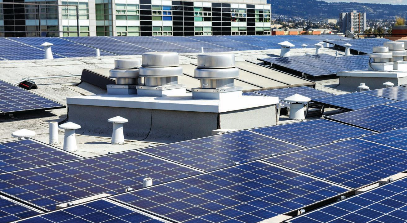 Commercial rooftop solar panel installation.